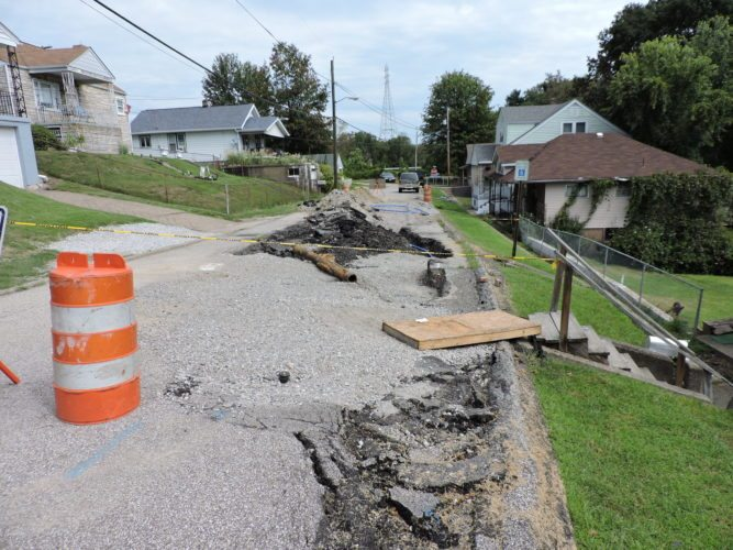 Photo by Shelley Hanson / A section of North Eighth Street in Martins Ferry remains closed due to a large road slip that broke a waterline.