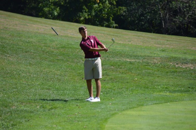 Photo by Cody Tomer / Wheeling Central's Kyle Wensel delivers a shot to the green in Monday's OVAC Championship at Crispin Golf Course.