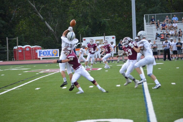 Photo by Josh Strope Wheeling Central's Robert Kahle (10) breaks up a pass during last week's victory against Madonna.
