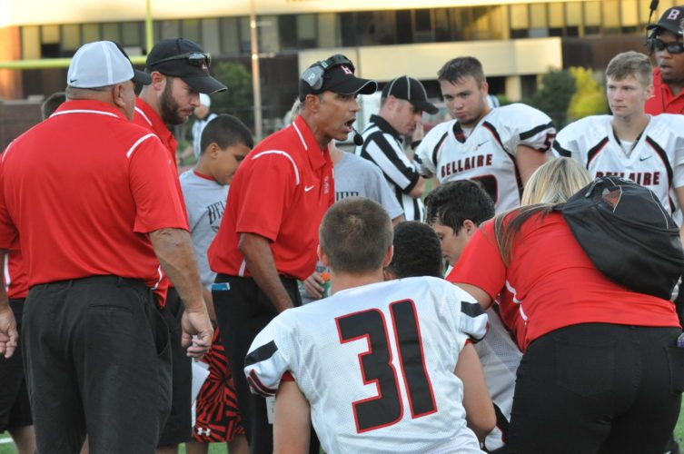 Bellaire coach Mark  Spigarelli talks to his team  during a timeout.  Photo by Andy Lloyd