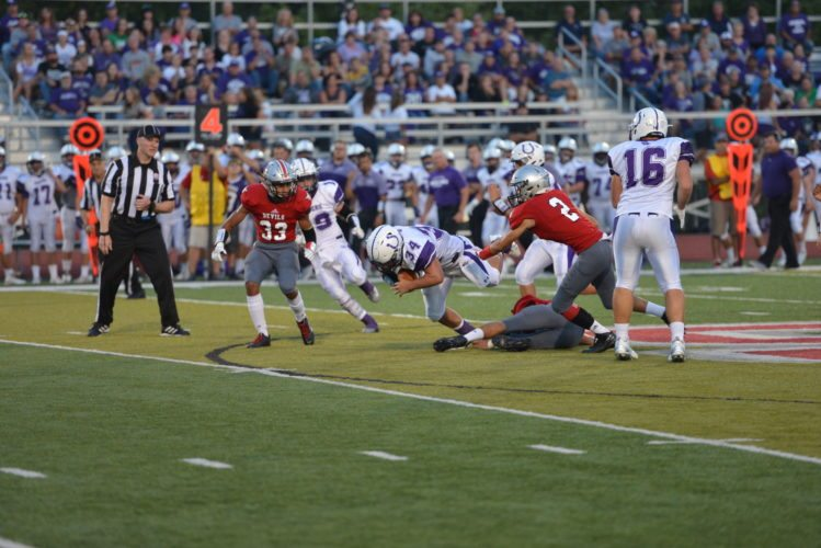 Martins Ferry's  Dalton Hoover (34) is tripped up during  Friday's game against St. Clairsville.  Photo by  Scott McCloskey