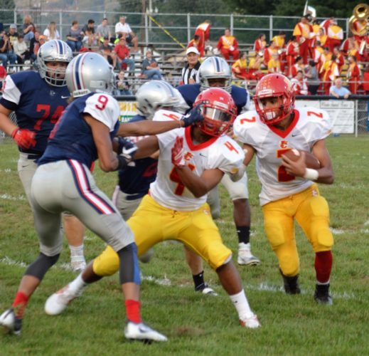Photo by Mike Mathison Indian Creek's Greg Wade (2) looks to run as Trey Harton blocks Buckeye Local's Dominick Brock.