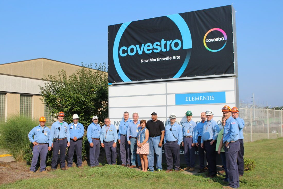 Photo Provided Covestro employees gather in front of the plant's sign.