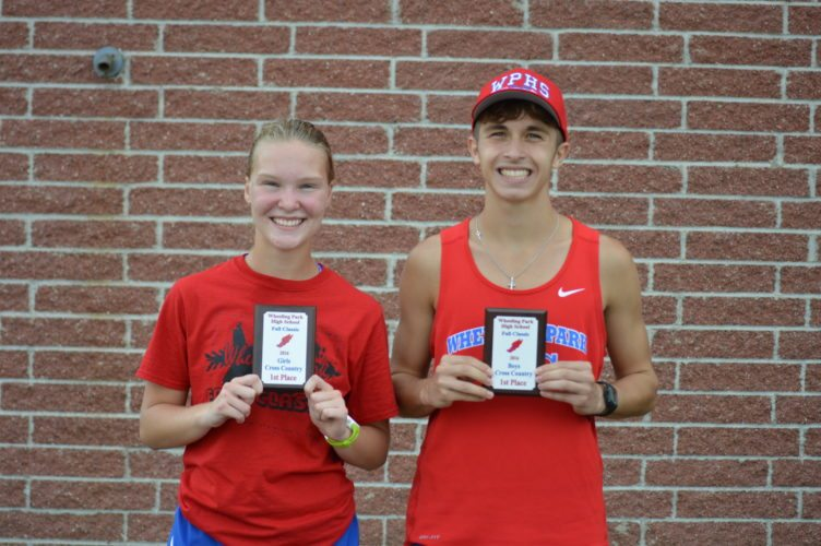 Photo by Cody Tomer Wheeling Park's Beighley Ayers and Corbin Rutan smile while showing off their champions' plaques.