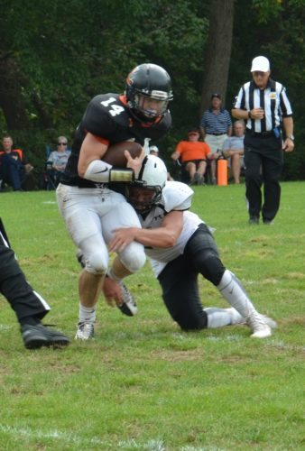 Photo by Seth Staskey Linsly's Gage Giovengo (14) is tackled by a Kiski player during Saturday's game.