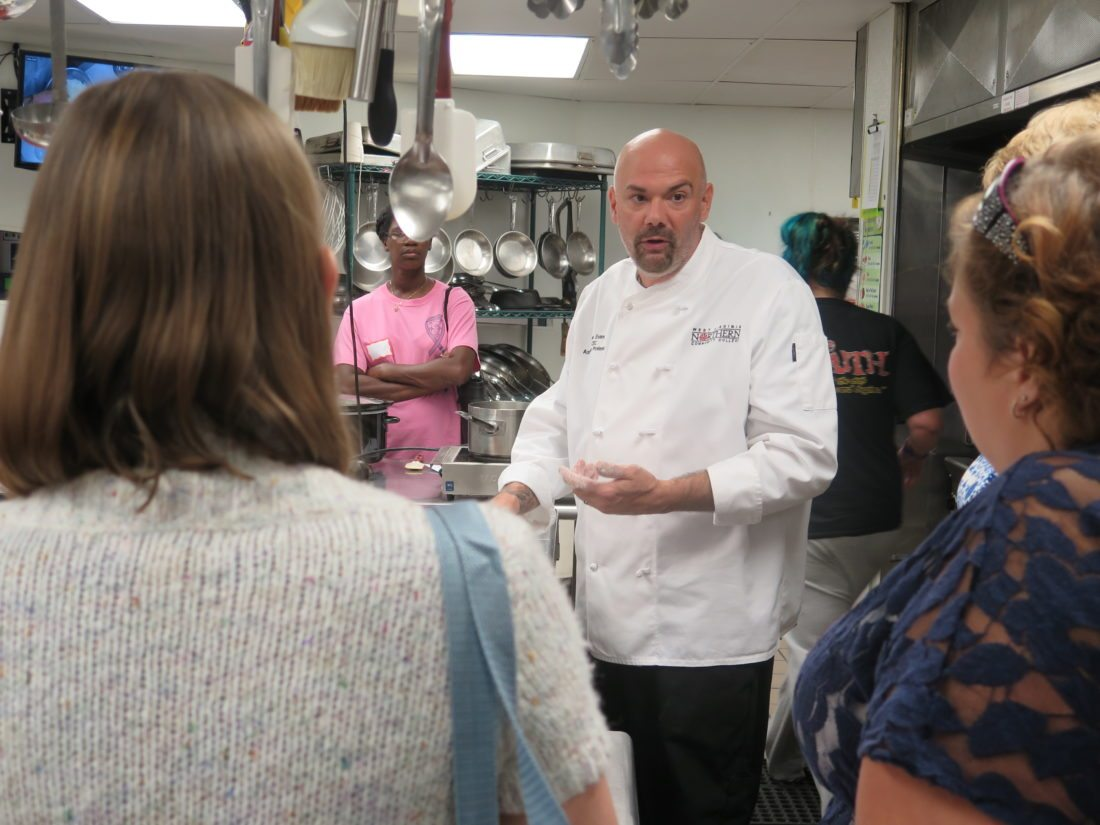 Photo by Alec Berry Gene Evans, assistant professor of culinary arts at West Virginia Northern Community College, instructs program participants on how to make cornbread dumplings.