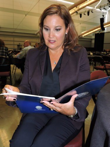 Photo by Casey Junkins  Ohio Lt. Gov. Mary Taylor reviews a brochure Thursday in Pittsburgh.