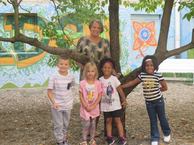 "Photos by Joselyn King Kindergarten teacher Nancy Peluchette stands in ""Madison Square Garden"" at Madison Elementary School with students, from left, Xavier Loos, Rosella Martin, Ava Rayford and Neveigha Bush."