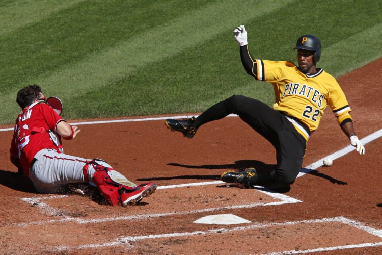 Pittsburgh Pirates' Andrew McCutchen, right, scores from third on a throw down to second by Washington Nationals catcher Jose Lobaton in the first inning of a baseball game in Pittsburgh, Sunday, Sept. 25, 2016. (AP Photo/Gene J. Puskar)