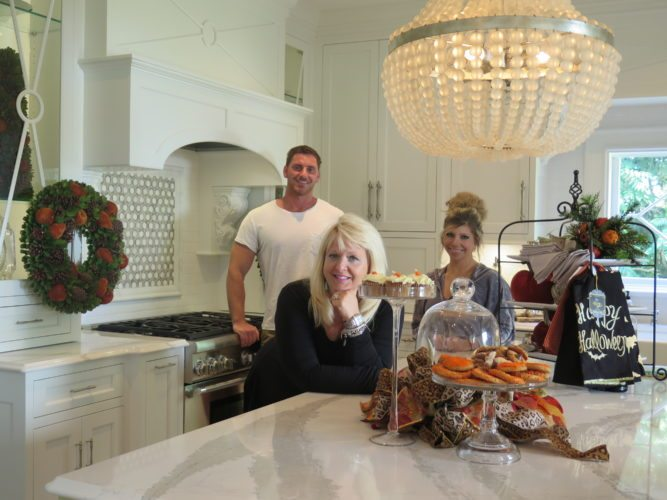 Photo by Joselyn King / Kelly Cappelletti, front, principal designer at Kelly's Suite II in St. Clairsville; Darek Wilson, main designer; and Erica DeFilippo, design assistant, show off the chef's kitchen found at their new design studio, located at 235 West Main St. in St. Clairsville.