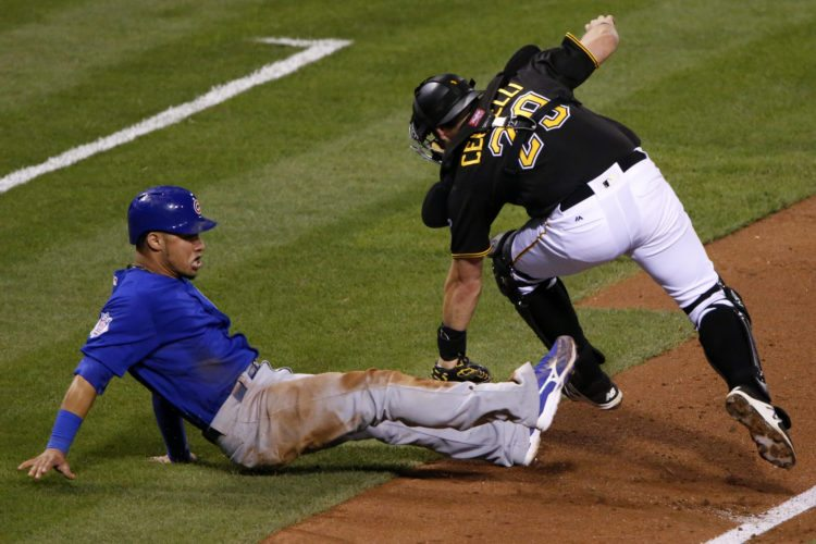 Pittsburgh Pirates catcher Francisco Cervelli tags out Chicago Cubs' Willson Contreras to end a rundown between third and home during the sixth inning of a baseball game in Pittsburgh, Monday, Sept. 26, 2016. (AP Photo/Gene J. Puskar)