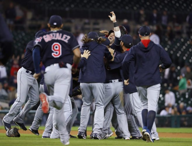 Cleveland Indians' Jason Kipnis celebrates with teammates after the Indians defeated the Detroit Tigers 7-4 in a baseball game in Detroit, Monday, Sept. 26, 2016. The Indians clinched the AL Central. (AP Photo/Paul Sancya)