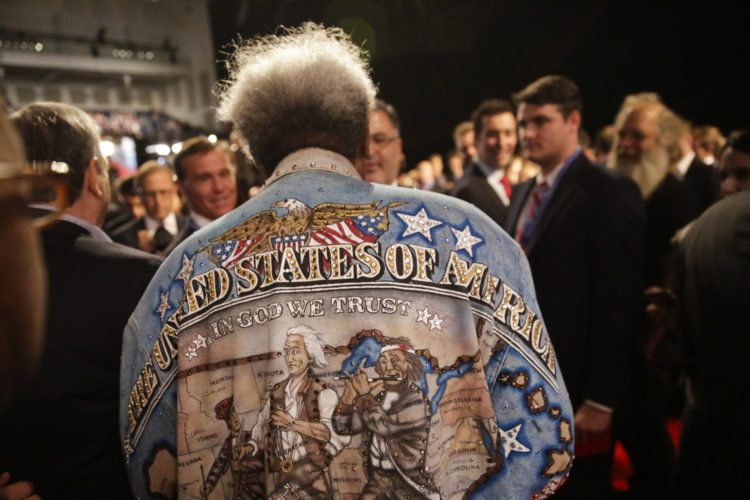 Boxing promoter Don King walks through the audience before the presidential debate between Democratic presidential nominee Hillary Clinton and Republican presidential nominee Donald Trump at Hofstra University in Hempstead, N.Y., Monday, Sept. 26, 2016. (AP Photo/David Goldman)
