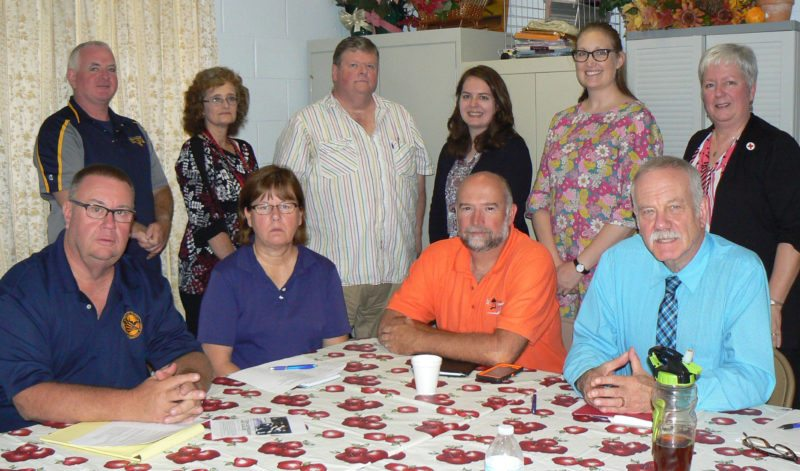 Photo Provided Several groups have teamed to form the Follansbee Long-Term Recovery Team focused on helping victims of the city's flooding on July 30. Gathered to discuss plans at the Brooke County Salvation Army Service Center were, seated, from left, Bob Fowler, Brooke County emergency management director; the Rev. Penny Calmbacher of Follansbee United Methodist Church; Mike Linger of House of the Carpenter; and George Smoulder, executive director of the United Way of the Upper Ohio Valley: and standing, Andy Nickerson, Brooke County EMA assistant director; Barb McConnell, Brooke County Salvation Army office manager; the Rev. Frank Haas of Follansbee Presbyterian Church; Liz Paulhus, director of program development and evaluation for Catholic Charities West Virginia; Andrea Staron, Northern Region director, Catholic Charities West Virginia; and Sharon Kesselring, executive director, American Red Cross of Northwest West Virginia.
