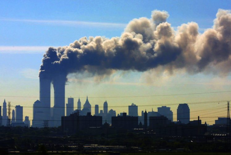 AP Photo / In this Sept. 11, 2001 photo, as seen from the New Jersey Turnpike near Kearny, N.J., smoke billows from the twin towers of the World Trade Center in New York after airplanes crashed into both towers.