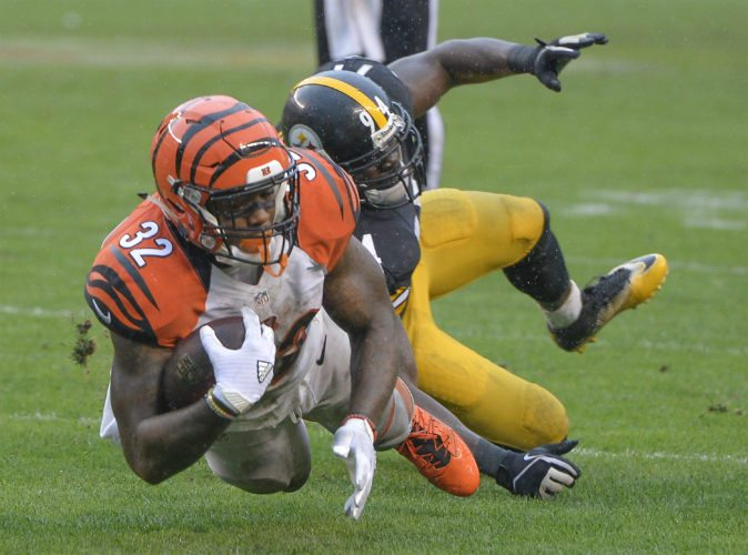 Cincinnati Bengals running back Jeremy Hill (32) is tackled by Pittsburgh Steelers inside linebacker Lawrence Timmons (94) during an NFL football game Sunday, Sept. 18, 2016, in Pittsburgh.  The Steelers defeat the Bengals 24-16. (Doug Kapustin/AP Images for Panini)