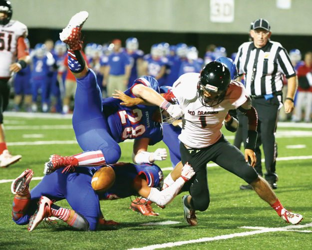Photo by Alex Kozlowski / Wheeling Park's Scotty Meagie (28) strips the ball from St. Albans' Jayson Barrett (1) during Friday's contest in Wheeling.