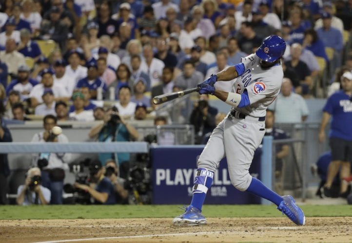 Chicago Cubs' Dexter Fowler hits an RBI single during the sixth inning of Game 4 of the National League baseball championship series against the Los Angeles Dodgers Wednesday, Oct. 19, 2016, in Los Angeles. (AP Photo/David J. Phillip)