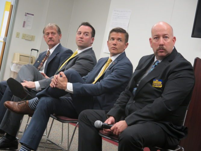 Photo by Alec Berry Congressional candidate Mike Manypenny, from left, Delegate Shawn Fluharty, D-Ohio, Delegate and state Senate candidate Ryan Weld, R-Brooke, and Ohio County sheriff candidate Tom Howard attend a candidate forum Thursday at West Virginia Northern Community College in Wheeling.