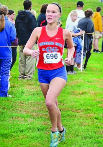 Wheeling Park's Beighley Ayers approaches the finish line during the regional meet Thursday.