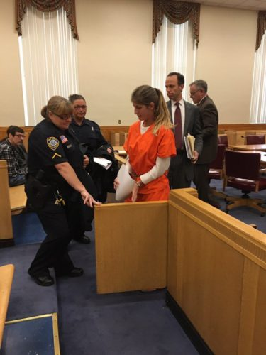 Photo by Drew Parker Kimberly Sue Evans is escorted from court after pleading guilty to involuntary manslaughter Friday in Marshall County Circuit Court.