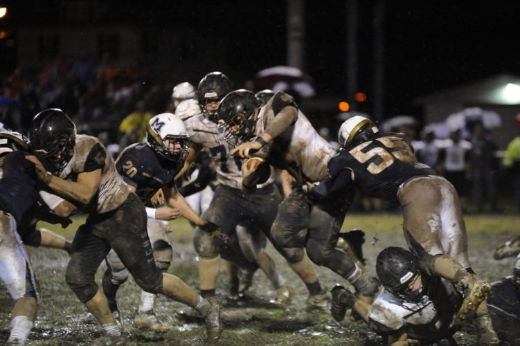 Tyler  Consolidated's Tyler Anderson battles for yardage Friday night against Magnolia.  Photo by  Robby Parsons