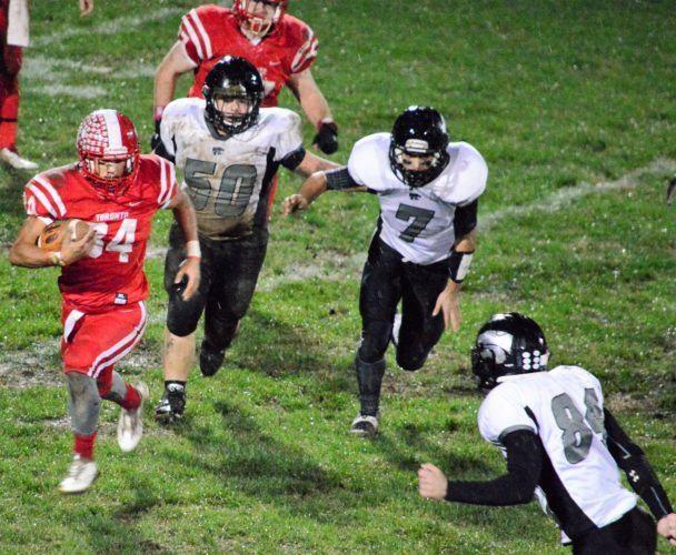 Photo by Mike Mathison Toronto's Max Tice carries as Edison's Mason Balzano (50) and (7) Storm Vincenzo give chase.