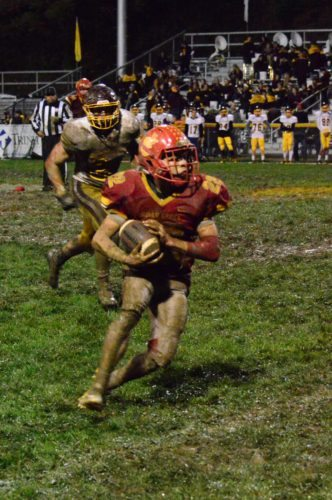 Photo by Mike Mathison Indian Creek's Austin Rawson looks for running room after catching a pass against South Range.