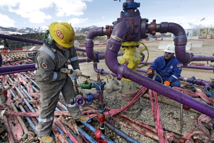 "FILE - In this March 29, 2013 file photo, workers tend to a well head during a hydraulic fracturing operation at an Encana Oil & Gas (USA) Inc. gas well outside Rifle, in western Colorado. The Obama administration is proposing a rule that would require companies that drill for oil and natural gas on federal lands to publicly disclose chemicals used in hydraulic fracturing operations. The new ""fracking"" rule replaces a draft proposed last year that was withdrawn amid industry complaints that federal regulation could hinder an ongoing boom in natural gas production.  (AP Photo/ Brennan Linsley, File)"