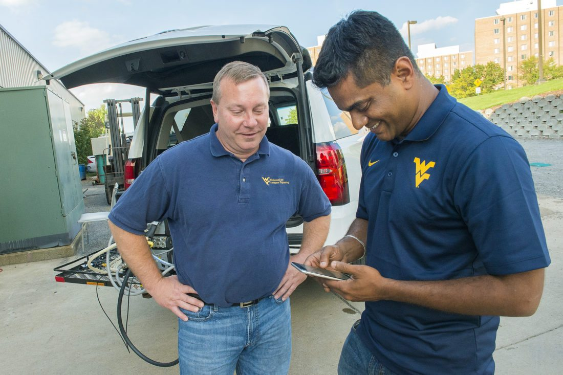 CAFEE Director Dan Carder, left, and Arvind Thiruvengadam talk as they work outside of the lab in this Oct. 2015 file photograph.