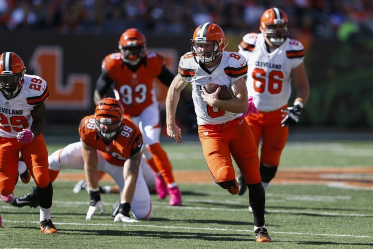 Cleveland Browns quarterback Kevin Hogan (8) runs for a touchdown in the second half of an NFL football game against the Cincinnati Bengals, Sunday, Oct. 23, 2016, in Cincinnati. (AP Photo/Gary Landers)