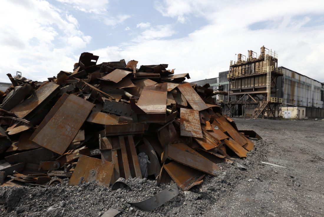 In this Thursday, Sept. 8, 2016, photo, a pile of rubble lies next to a dust collector for a carbon storage room of the former Ormet plant, at the site in Hannibal, Ohio.