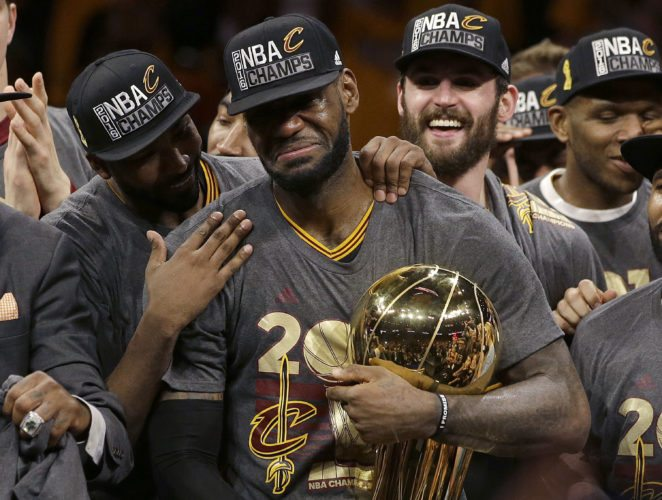 "FILE - In this June 19, 2016, file photo, Cleveland Cavaliers forward LeBron James, center, celebrates with teammates, including Kevin Love, third from left, after Game 7 of basketball's NBA Finals against the Golden State Warriors in Oakland, Calif. James delivered on his personal pledge to bring home a title in June. And although it's one he can never duplicate personally or for a fan base that had its heart broken and healed by him, the Cavaliers' superstar and his teammates aren't resting, getting comfortable or complacent. They want more. ""We're still pretty much uptight,"" James said. ""We're not satisfied with what we did."" (AP Photo/Marcio Jose Sanchez, File)"