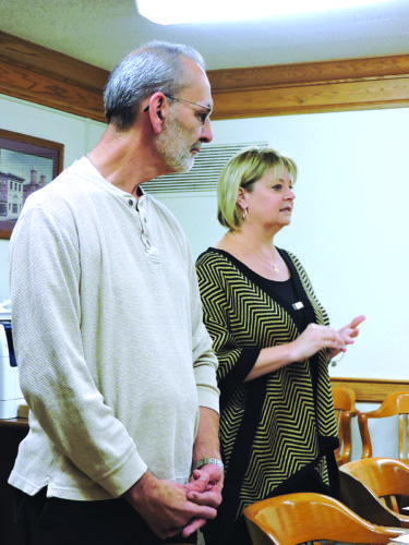 Photo by Alan Olson Marshall County Administrator Betsy Frohnapfel, right, and Youth Services System CEO John Moses address county commissioners Tuesday.