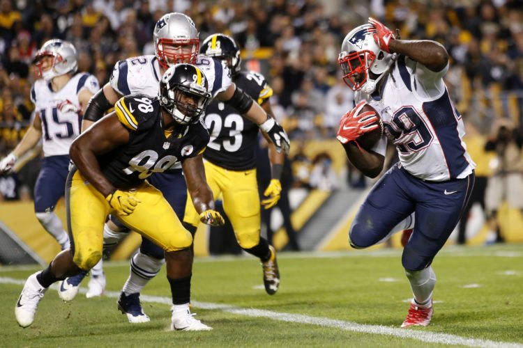 New England Patriots running back LeGarrette Blount (29) gets into the end zone for a touchdown past Pittsburgh Steelers inside linebacker Vince Williams (98) during the second half of an NFL football game in Pittsburgh, Sunday, Oct. 23, 2016. (AP Photo/Jared Wickerham)
