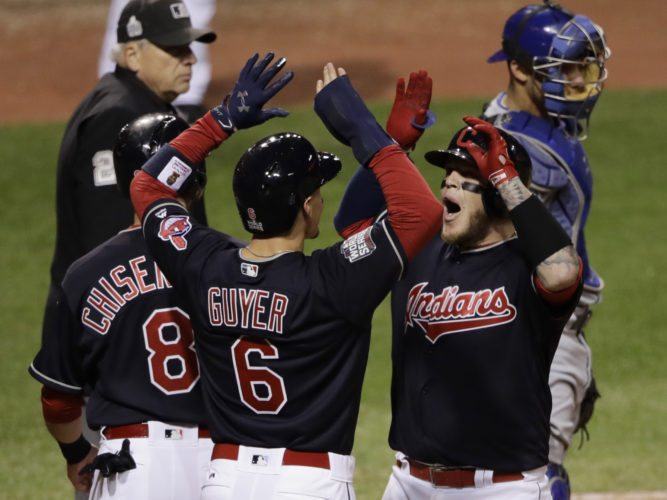Cleveland Indians' Roberto Perez celebrates with Brandon Guyer (6) and Lonnie Chisenhall (8) after hitting a three-run home run during the eighth inning of Game 1 of the Major League Baseball World Series against the Chicago Cubs Tuesday, Oct. 25, 2016, in Cleveland. (AP Photo/Gene J. Puskar)