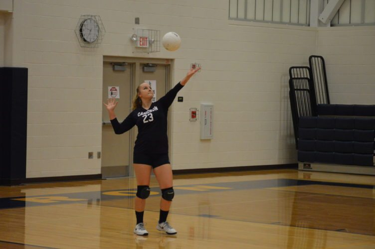 Photo by Cody Tomer Cameron's Kelsie Meintel prepares to serve during Tuesday's match against Weirton Madonna.