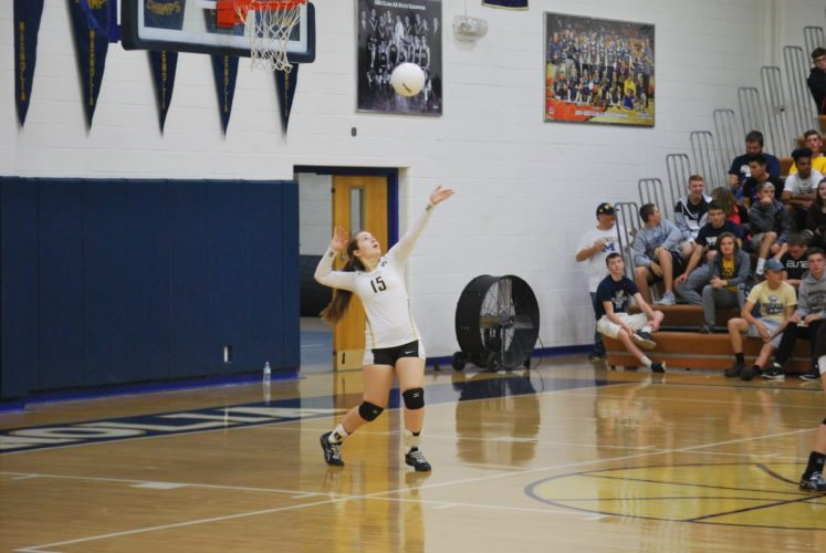 Photo by Cody Tomer John Marshall's Megan Denning serves during a match at Magnolia on Thursday. xxx