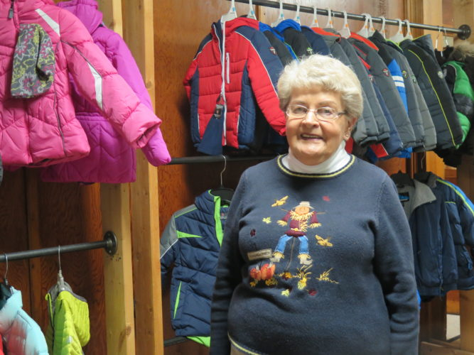 Photo by Joselyn King Coat Closet of Belmont County volunteer  Margaret Paolucci shows off coats donated to the coat closet.