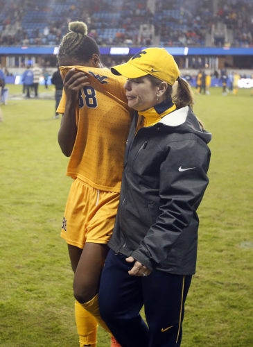 West Virginia head coach Nikki Izzo-Brown, right, consoles Kadeisha Buchanan after their 3-1 loss to Southern California in the NCAA Women's College Cup soccer final Sunday, Dec. 4, 2016 in San Jose, Calif. (AP Photo/Tony Avelar)