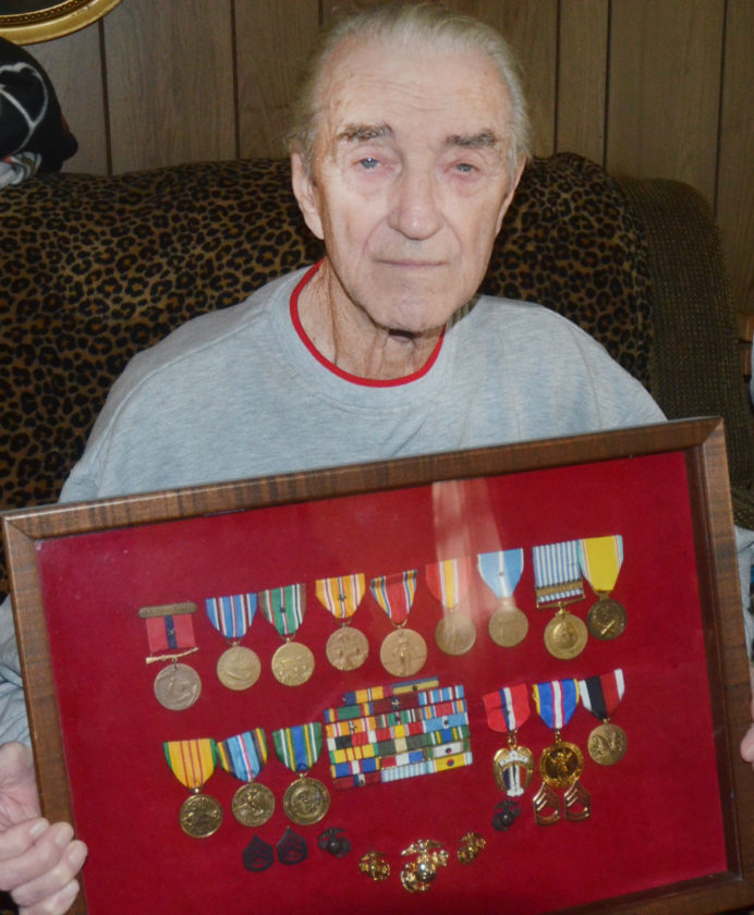 "Photo by Scott McCloskey World War II veteran Robert ""Dale"" Sigler of Moundsville displays the many medals he earned while serving in the military."