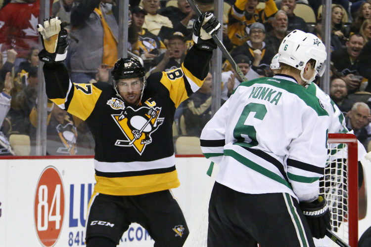 FILE - In this Dec. 1, 2016, file photo, Pittsburgh Penguins' Sidney Crosby (87) celebrates his goal in the second period of an NHL hockey game against the Dallas Stars in Pittsburgh. Sidney Crosby can't seem to find the right word for what's happening. If the Pittsburgh Penguins captain is being honest, he's not really interested in finding one. He'd rather just enjoy a hot streak that's bordering on absurd even by his remarkably high standards. (AP Photo/Gene Puskar, File)
