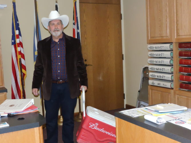 "Belmont County  Commissioner Matt Coffland brings his cowboy hat and cooler to Wednesday's commission meeting in protest of the planned changes to the former  Jamboree In The Hills  festival, now called ""Jambo  Country."""