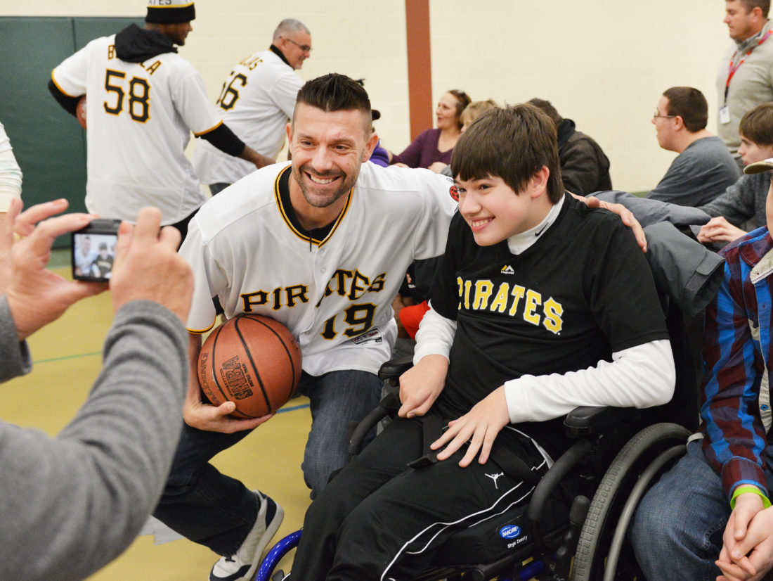 Photo by Scott McCloskey Pittsburgh Pirates catcher Chris Stewart, left, poses with Austin McCardle of Wheeling during a visit with the Miracle League of the Ohio Valley at the J.B. Chambers YMCA in Elm Grove Friday.