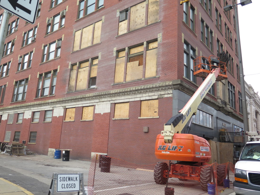 Photo by Alec Berry  The Mull Center in downtown Wheeling undergoes facade improvements.