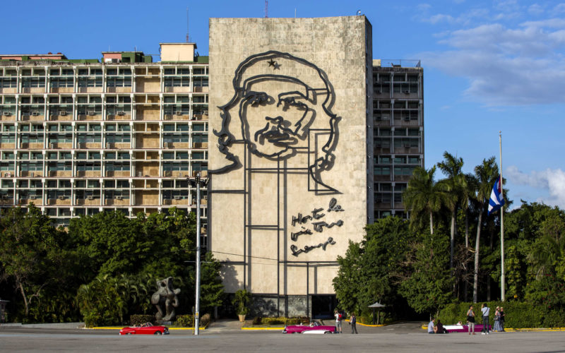 """FILE - This Nov. 27, 2016 file photo shows the iconic image of Cuba's revolutionary hero Ernesto """"Che"""" Guevara, at Revolution Square near the Ministry of Interior in Havana, Cuba. Some Americans may rush to see Cuba in 2017, worried that the Trump administration will tighten travel rules. Others may postpone plans until they see what the new administration does. (AP Photo/Desmond Boylan, File)"""