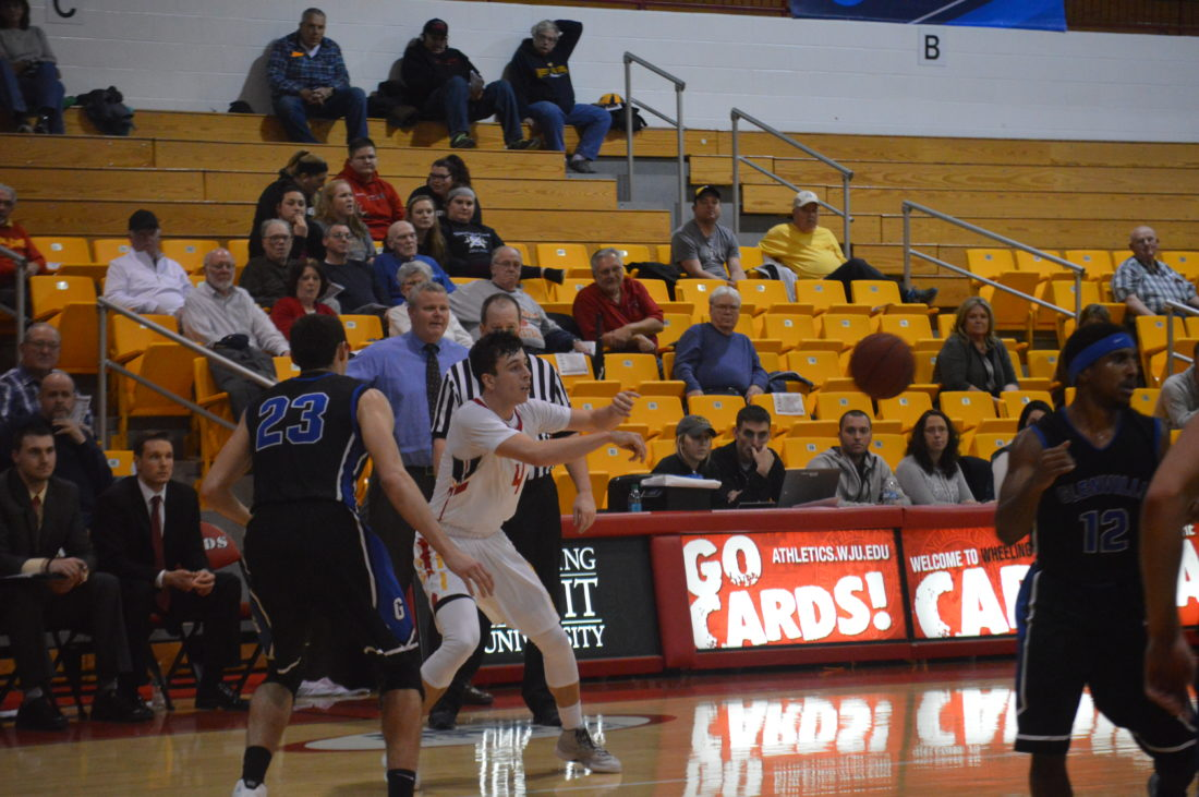 Photo by KyleLutz Wheeling Jesuit's Preston Boswell dishes the ball out to a teammate during Tuesday night's game.