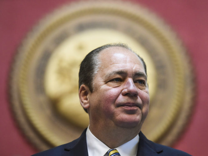 West Virginia Gov. Earl Ray Tomblin gives a farewell address to a joint session on Wednesday, Jan. 11, 2017, in the House chamber at the West Virginia Capitol in Charleston, W.Va.. Tomblin, a Democrat, leaves after two terms and six years in office. (Sam Owens/Charleston Gazette-Mail via AP)