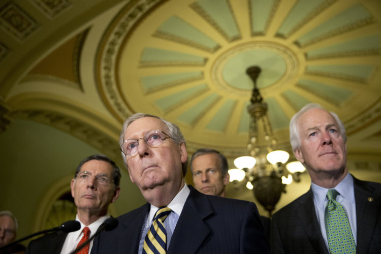 FILE - In this June 21,2016 file photo, Senate Majority Leader Mitch McConnell of Ky., accompanied by, from left, Sen. John Barrasso, R-Wyo., Sen. John Thune, R-S.D., and Senate Majority Whip John Cornyn of Texas, listen to a question during a news conference on Capitol Hill in Washington. Congressional Republicans are taking the first steps toward dismantling President Barack Obama's health care law, facing pressure from President-elect Donald Trump to move quickly on a replacement.  (AP Photo/Alex Brandon, File)