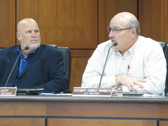 Photo by Alec Berry Wheeling Public Works Director Russell Jebbia, right, speaks as 6th Ward Councilman Dave Palmer listens.